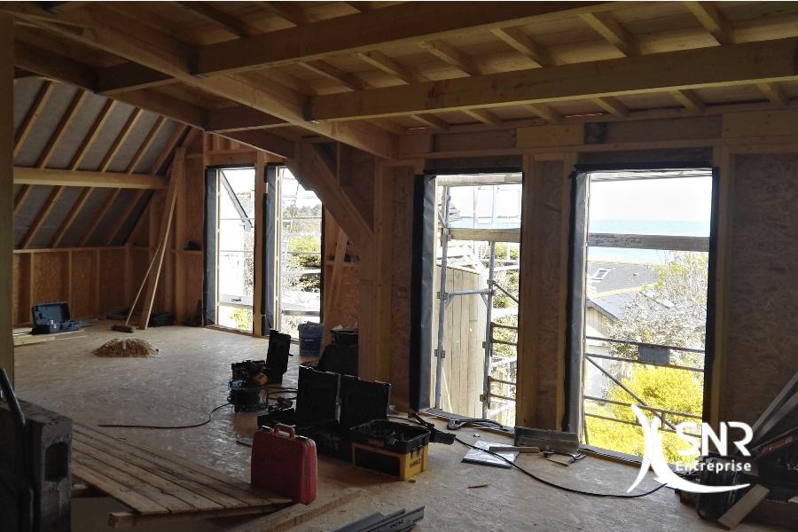 Création d'une surélévation d'un bâtiment existant et raccordement avec un agrandissement maison rennes réalisé par SNR