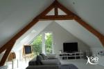 Jouez avec les pentes de toiture et faites entrer un maximum de lumière dans les combles aménagés avec SNR Entreprise