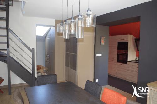 Pose de parquet stratifié et création de percements dans des murs porteurs pour cette extension maison laval