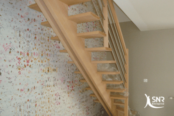 Mise en place d'un escalier à double limon central pour accéder aux combles aménagés avec SNR Entreprise
